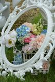 Vintage flower arrangment. Vintage flower display with photo frame and bird cage Royalty Free Stock Image