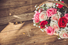 Vintage flower rose in the basket background. Royalty Free Stock Photos