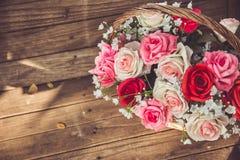 Vintage flower rose in the basket. Royalty Free Stock Image