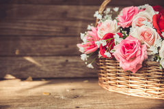 Vintage flower rose in the basket Royalty Free Stock Photos