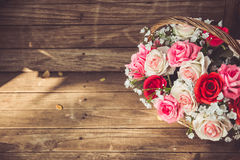 Vintage flower rose on wood. Royalty Free Stock Photo