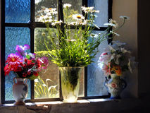 Vintage flower vases on old window Stock Photography