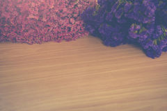 Vintage flower on wooden table Royalty Free Stock Images