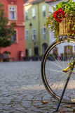 Vintage Flowerpot and Bicycle. Flowers on a Bicycle in the main Square of Sighisoara, Tansylvania royalty free stock images