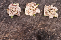 Vintage flowers. Handcrafted vintage flowers line the top of old barn wood Stock Image