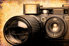 Vintage folding camera with a grunge texture Royalty Free Stock Photos