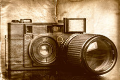 Vintage folding camera with a grunge texture Stock Photo