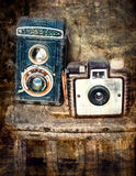 Vintage folding camera with a grunge texture Stock Image