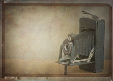 Vintage folding camera. Textured image of a vintage folding camera Stock Photography