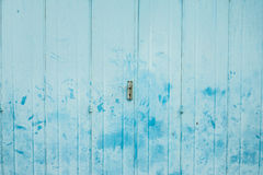The vintage folding metal door with light blue painted and hand print stain Stock Photography
