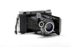 Vintage Folding Rangefinder Film Camera Isolated on White Background. Folding bellows medium format film camera on white background Royalty Free Stock Photography