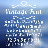 Vintage font lettering on abstract blurry Royalty Free Stock Images