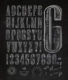 Vintage font letters chalk. Vintage font set letters in retro style old alphabet on chalkboard Royalty Free Stock Images