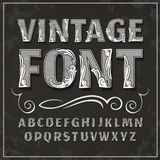 Vintage font. Retro font. Vintage label font. Alcogol label style with vintage ornament royalty free stock photo