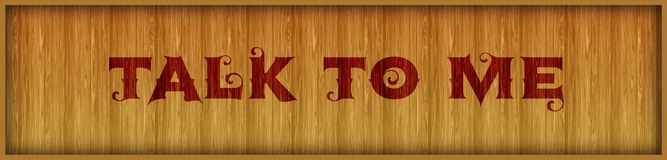 Vintage font text TALK TO ME on square wood panel background. Royalty Free Stock Images