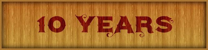 Vintage font text 10 YEARS on square wood panel background. Illustration Vector Illustration