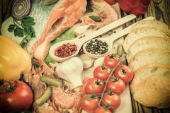 Vintage Food - Fish and Shrimps. Vintage food background, fish and shrimps with spices on wooden board Stock Image