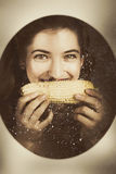 Vintage food product advert. Woman eating corncob Royalty Free Stock Photo