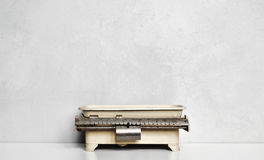 Vintage food scale on gray wall Royalty Free Stock Photos
