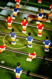 Vintage Foosball, Table Soccer or Football Kicker Game. Vintage Foosball, Blue and Red Players Team in Table Soccer or Football Kicker Game, Selective Focus Stock Images