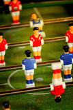 Vintage Foosball, Table Soccer or Football Kicker Game. Vintage Foosball, Blue and Red Players Team in Table Soccer or Football Kicker Game, Selective Focus Royalty Free Stock Images