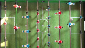 Vintage Foosball, Table Soccer or Football Kicker Game. Vintage Foosball Known as Table Soccer, Blue and Red Players in Football Kicker Game, Selective Focus stock video