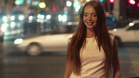 Vintage footage of bachelorette in light dress in the night city. With blurred lights on background stock video