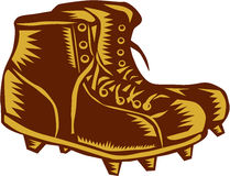 Vintage Football Boots Woodcut. Illustration of a vintage style football rugby boots viewed from side set on  white background done in retro woodcut style Royalty Free Stock Photos
