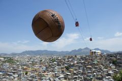 Vintage Football Soccer Ball Rio de Janeiro Brazil Favela. Vintage brown football soccer ball flying in the sky with red cable cars above Rio de Janeiro Brazil royalty free stock photos