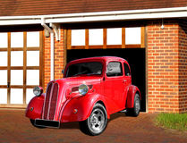 Vintage ford anglia car on driveway. Photo of a vintage customised ford anglia car highly polished ready for a cruise into town royalty free stock photography