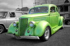 Vintage ford custom car. Photo of a lime green vintage ford custom car showing at whitstable vintage car show on tankerton slopes on 17th august 2014.photo ideal Stock Image