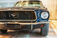 Vintage ford mustang 289. RIMINI , Italy - FEBRARY 12, 2017:Vintage ford mustang 289 vintage car stands parked royalty free stock images