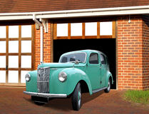 Vintage ford prefect on driveway. Photo of an open garage door with vintage ford prefect on driveway Royalty Free Stock Images