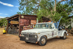 Vintage Ford tow truck in Hackberry, Arizona. HACKBERRY, ARIZONA, USA - MAY 19, 2016 : Vintage Ford tow truck left abandoned near the Hackberry General Store Stock Photo