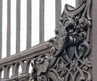 Vintage forged decorative element on metal gate. Stock Photos