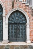 Vintage forged gate. Under building stairs in Venice, Italy royalty free stock photos