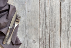 Vintage fork and knife on wood Stock Images