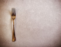 Vintage fork over grunge Stock Photos