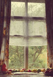 Vintage foto of the old window. tomatoes lie near a window Royalty Free Stock Images