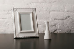 Vintage fotoframe and vase. Composition with vintage fotoframe and vase Royalty Free Stock Photo