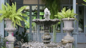 Vintage fountain in coffee shop garden stock footage