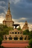 Vintage fountain near Moscow State Lomonosov University / Stalin skyscraper. Antique fountain with dolphins, Moscow state University, Parks and fountains of Royalty Free Stock Images