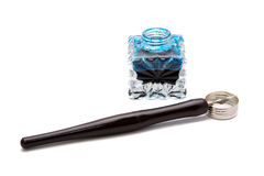 Vintage fountain pen and inkwell isolated Stock Image