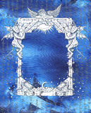 Vintage frame with angel, demons and mystic symbols on blue Royalty Free Stock Photography