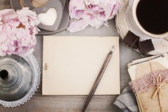 Vintage Frame with Black Coffee, Flower, Pen and Old Paper stock photo