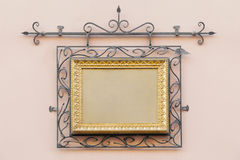 Vintage frame decorated with wrought iron Stock Photos