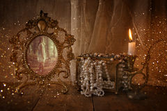 Vintage frame with old photo, pearls and candle Royalty Free Stock Photo