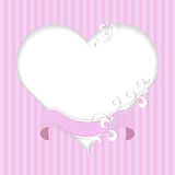 Vintage frame in shape of a heart with ribbon and plant pattern on pink background. Stock Photo