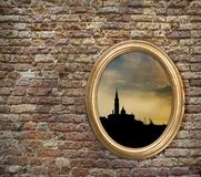 Vintage frame with the silhouette of Venice on an old brick wall. royalty free stock photo