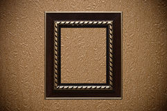 Vintage frame on textured wallpaper Stock Photos